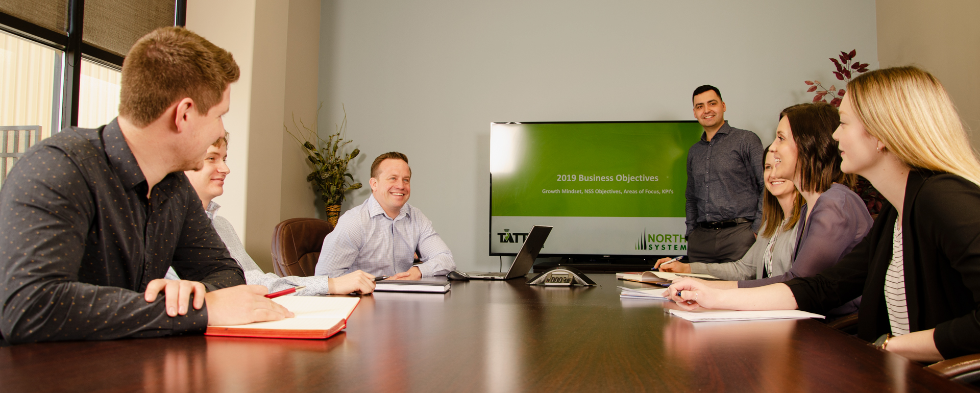 North Star Systems Team around boardroom table in Saskatoon